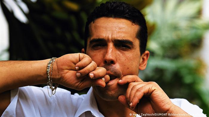 Spain La Gomera - Local demonstrates whistling language