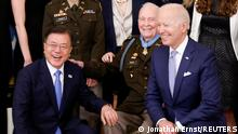 U.S. President Joe Biden and South Korea's President Moon Jae-in pose for a picture with Korean War-era Army Colonel Ralph Puckett during a Medal of Honor ceremony for Puckett in the East Room at the White House, in Washington, U.S. May 21, 2021. REUTERS/Jonathan Ernst