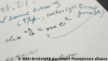 In this undated photograph, provided by Boston-based RR Auction, shows a letter written by Albert Einstein, in which he wrote out his famous E = mc2 equation, that sold at auction for more than $1.2 million. Archivists at the Einstein Papers Project at the California Institute of Technology and the Hebrew University of Jerusalem say there are only three other known examples of Einstein writing the world-changing equation in his own hand. (Nikki Brickett/RR Auction via AP)