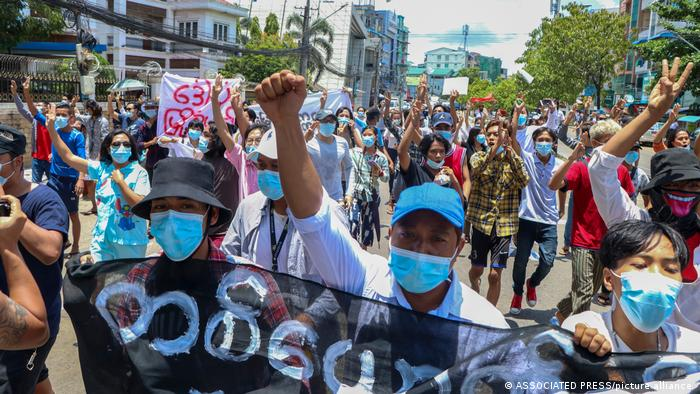 Protesters march in Yangon