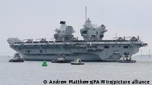 HMS Queen Elizabeth. The Royal Navy aircraft carrier HMS Queen Elizabeth leaves Portsmouth Naval Base in Hampshire for exercises off Scotland before heading to the Indo-Pacific region. Picture date: Saturday May 1, 2021. Photo credit should read: Andrew Matthews/PA Wire URN:59511024