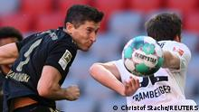 Soccer Football - Bundesliga - Bayern Munich v FC Augsburg - Allianz Arena, Munich, Germany - May 22, 2021 Bayern Munich's Robert Lewandowski in action Pool via REUTERS/Christof Stache DFL regulations prohibit any use of photographs as image sequences and/or quasi-video.