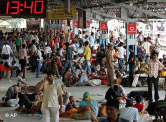 Stranded passengers wait at a railway station in Gauhati during a nationwide strike