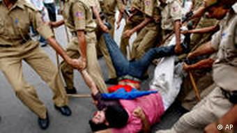 Communist Party of India supporters are dragged away by the police at a protest in New Delhi