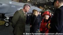 22.05.21 *** HMS Queen Elizabeth. Queen Elizabeth II meeting personnel during a visit to HMS Queen Elizabeth at HM Naval Base, Portsmouth, ahead of the ship's maiden deployment. The visit comes as HMS Queen Elizabeth prepares to lead the UK Carrier Strike Group on a 28-week operational deployment travelling over 26,000 nautical miles from the Mediterranean to the Philippine Sea. Picture date: Saturday May 22, 2021. See PA story ROYAL Carrier. Photo credit should read: Steve Parsons/PA Wire URN:59931617
