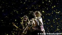 Italy's Maneskin celebrate on stage with the trophy after winning the final of the 65th edition of the Eurovision Song Contest 2021, at the Ahoy convention centre in Rotterdam, on May 22, 2021. (Photo by Kenzo Tribouillard / AFP)