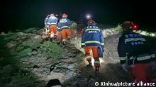 (210523) -- JINGTAI, May 23, 2021 (Xinhua) -- Rescuers search for missing people at the Yellow River Stone Forest tourist site in Jingtai County of Baiyin City, northwest China's Gansu Province, May 23, 2021. At least 16 people were confirmed dead and five others missing during a mountain marathon 100 km cross-country race in northwest China's Gansu Province, rescuers said Sunday. Extreme weather hit the area during the race which was held on Saturday morning in the Yellow River Stone Forest tourist site in Jingtai County, Baiyin City. (Xinhua)