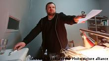 Board member of an NGO organization that monitors racism and xenophobia, Rafal Gawel, stands in his office in Warsaw, Poland, Friday, Feb. 3, 2017, shortly after it was raided by the police who seized computers. He said the early-morning raid on the Monitoring Center on Racist and Xenophobic Behavior was an attempt to intimidate it and destroy evidence that is inconvenient for the authorities. (AP Photo/Czarek Sokolowski)