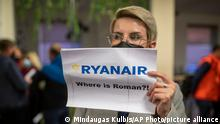 A woman holds a poster reads where is Raman Pratasevich?! as she waits to see passengers of the Ryanair plane with registration number SP-RSM, carrying opposition figure Raman Pratasevich which was traveling from Athens to Vilnius and was diverted to Minsk after a bomb threat, after its landing at the International Airport outside Vilnius, Lithuania, Sunday, May 23, 2021. The presidential press service said President Alexander Lukashenko personally ordered that a MiG-29 fighter jet accompany the Ryanair plane carrying opposition figure Raman Pratasevich and traveling from Athens, Greece, to Vilnius, Lithuania to the airport in the capital Minsk. (AP Photo/Mindaugas Kulbis)