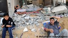 Palestinians rest after returning to their damaged house following Israel- Hamas truce, in Beit Hanoun in the northern Gaza Strip, May 21, 2021. REUTERS/Mohammed Salem