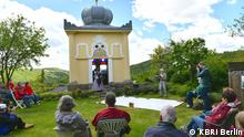 Raden Saleh in Maxen.png Title: Commemorate the birthday of Raden Saleh Image Description: Hundreds of residents of Maxen city and its surroundings flocked to the Blue House (Blaues Häusel) in Maxen City founded by german nobleman Friedrich Anton Serre in 1848. The goal was to commemorate the birthday of Raden Saleh, a Javanese man who had lived and worked in the small town in the period 1839-1849. Tags: raden saleh, maxen, artist, indonesian Who took the picture / photographer: KBRI Berlin When was the picture taken: 22 May 2021 Where was the picture taken: Maxen
