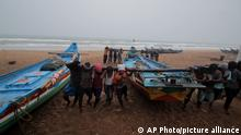Fishermen shift their boats to safer grounds as a precaution against Cyclone Yaas at the Puri beach on the Bay of Bengalcoast in Odisha, India, Monday, May 24, 2021. The storm was forecast to hit the eastern states of West Bengal and Odisha on Wednesday. (AP Photo)