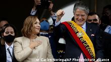 Ecuador's new President Guillermo Lasso, right, and first lady Maria de Lourdes de Lasso, left, greet the crowd from the balcony of Carondelet Palace, Ecuador's seat of government, in Quito, Monday, May 24, 2021. (AP Photo/Carlos Noriega)