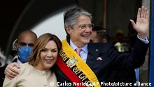 Ecuador's new President Guillermo Lasso, right, and first lady Maria de Lourdes de Lasso greet the crowd from the balcony of Carondelet Palace, Ecuador's seat of government, in Quito, Monday, May 24, 2021. (AP Photo/Carlos Noriega)