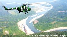 05.08.2015 Peruvian Army helicopters overfly the tactical VRAEM area, between the rivers Ene, Apurimac and Mantaro, some 280 km south east of Lima, on August 5, 2015, as part of operations against terrorism and drug trafficking in the region -- one of the largest coca production basins in the world and a natural hideout for guerrillas. Maoist group Sendero Luminoso (Shining Path), accountable for the conflict in Peru between 1980-2000 that left 69,000 dead, still has remnants causing havoc in remote villages. AFP PHOTO/CRIS BOURONCLE (Photo credit should read CRIS BOURONCLE/AFP via Getty Images)