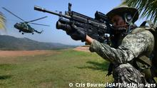 05.08.2015 Peruvian Army members are seen at the tactical VRAEM area, between the rivers Ene, Apurimac and Mantaro, some 280 km south east of Lima, on August 5, 2015, during operations against terrorism and drug trafficking in the region -- one of the largest coca production basins in the world and a natural hideout for guerrillas. Maoist group Sendero Luminoso (Shining Path), accountable for the conflict in Peru between 1980-2000 that left 69,000 dead, still has remnants causing havoc in remote villages. AFP PHOTO/CRIS BOURONCLE (Photo credit should read CRIS BOURONCLE/AFP via Getty Images)