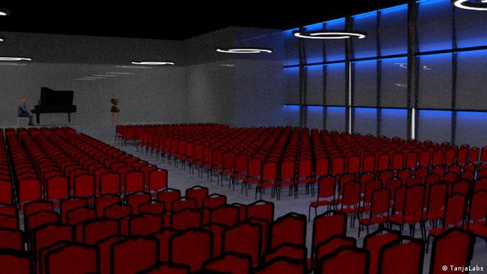 Rheingau Musik Festival Fürst von Metternich Konzert Kubus mit roten Stuhlreihen und blau beleuchteten Wänden.