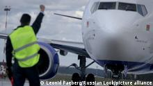16.08.2016 A ground crew greets the pilot of the Boeing 737-800 civil jet airplane of Belavia while arriving at Minsk International Airport, Belarus (Photo by Leonid Faerberg /Transport-Photo Images)