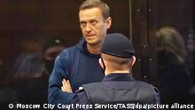 MOSCOW, RUSSIA — FEBRUARY 2, 2021: Opposition activist Alexei Navalny (back) appears at Moscow City Court for a Simonovsky District Court hearing into an application by the Russian Federal Penitentiary Service to convert his suspended sentence of three and a half years into a real jail term. Navalny, who had been wanted in Russia since December 2020 for violating probation conditions in the Yves Rocher case, was detained at Sheremetyevo Airport near Moscow on his return to Russia from Germany on 17 January 2021. On 18 January, Moscow Region's Khimki Court ruled that Navalny be put into custody until 15 February 2021. Moscow City Court Press Service/TASS THIS IMAGE WAS PROVIDED BY A THIRD PARTY. EDITORIAL USE ONLY