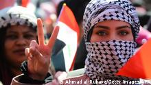 A Iraqi woman flashes the victory sign as she takes part in an anti-government demonstration in the capital Baghdad's Tahrir Square on February 13, 2020. - More than 540 Iraqis have been killed in protest-related violence accross Iraq since the rallies erupted, according to a recent toll by the Iraqi Human Rights Commission. (Photo by AHMAD AL-RUBAYE / AFP) (Photo by AHMAD AL-RUBAYE/AFP via Getty Images)