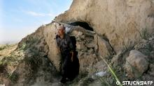 *****CHINA OUT**** This photo taken on May 24, 2021 shows shepherd Zhu Keming, hailed as a hero in China for rescuing six ultramarathon runners when extreme weather hit the area leaving at least 20 dead, showing the cave dwelling where he sheltered the stricken athletes near the city of Baiyin, in China's northwestern Gansu province. (Photo by STR / CNS / AFP) / China OUT