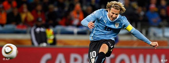 Uruguay's Diego Forlan kicks the ball to score a goal during the World Cup semifinal soccer match between Uruguay and the Netherlands at the Green Point stadium in Cape Town, South Africa, Tuesday, July 6, 2010.