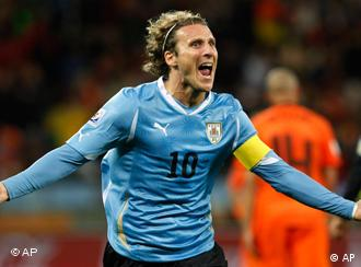 Uruguay's Diego Forlan celebrates after scoring his side's first goal during the World Cup semifinal soccer match between Uruguay and the Netherlands at the Green Point stadium in Cape Town, South Africa, Tuesday, July 6, 2010.