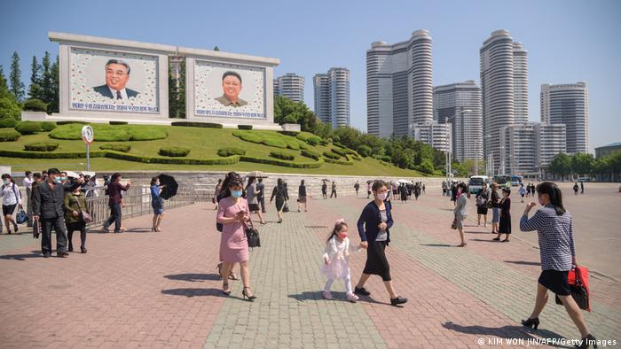 People walk through a square in Pyongyang. File photo from May 2021.
