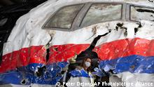 26.05.2021 Trial judges and lawyers view the reconstructed wreckage of Malaysia Airlines Flight MH17, at the Gilze-Rijen military airbase, southern Netherlands, Wednesday, May 26, 2021. (AP Photo/Peter Dejong, Pool)