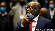 Former South African President Jacob Zuma stands in the dock after recess in his corruption trial in Pietermaritzburg, South Africa, May 26, 2021. Phill Magakoe/Pool via REUTERS