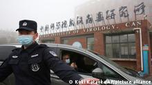 Security guard check at the gate of Wuhan Institute of Virology as a vehicle carrying the experts of World Health Organization (WHO) entered in Wuhan, Hubei Province, China on Feb. 3rd, 2021. WHO probe team members tackled to investigate into the origins of the Covid-19 pandemic. ( The Yomiuri Shimbun via AP Images )
