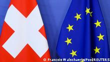 FILE PHOTO: Switzerland's national flag and the European Union flag are seen at the European Commission building in Brussels, Belgium April 23, 2021. Francois Walschaerts/Pool via REUTERS/File Photo