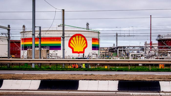 A Shell fuel installation next to a road, with the Shell logo surrounded by the stripes the color of the rainbow