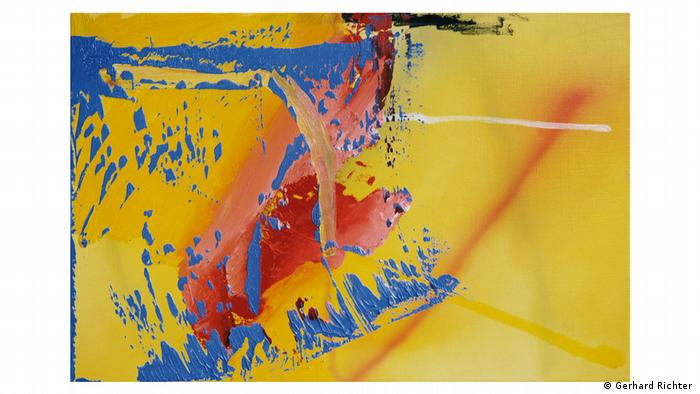 Gerhard Richter painting kept largely in shades of yellow and red. with splashed of blue.