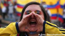 A demonstrator shouts during a protest demanding government action to tackle poverty, police violence and inequalities in healthcare and education systems, in Bogota, Colombia May 26, 2021. REUTERS/Luisa Gonzalez