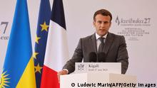 French President Emmanuel Macron delivers a speech during his visit to the Kigali Genocide Memorial, where some 250,000 victims of the massacres are buried, in Kigali on May 27, 2021. - French President Emmanuel Macron arrived in Rwanda on May 27, 2021, for a highly symbolic visit aimed at moving on from three decades of diplomatic tensions over France's role in the 1994 genocide in the country. Macron is the first French leader since 2010 to visit the East African nation, which has long accused France of complicity in the killing of some 800,000 mostly Tutsi Rwandans. - RESTRICTED TO EDITORIAL USE - MANDATORY MENTION OF THE ARTIST UPON PUBLICATION - TO ILLUSTRATE THE EVENT AS SPECIFIED IN THE CAPTION (Photo by Ludovic MARIN / AFP) / RESTRICTED TO EDITORIAL USE - MANDATORY MENTION OF THE ARTIST UPON PUBLICATION - TO ILLUSTRATE THE EVENT AS SPECIFIED IN THE CAPTION / RESTRICTED TO EDITORIAL USE - MANDATORY MENTION OF THE ARTIST UPON PUBLICATION - TO ILLUSTRATE THE EVENT AS SPECIFIED IN THE CAPTION (Photo by LUDOVIC MARIN/AFP via Getty Images)