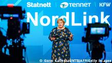 Norway's Prime Minister Erna Solberg attends the official opening of NordLink, the first power connection between Norway and Germany on May 27, 2021 in Oslo. - Germany and Norway are inaugurating an undersea cable connecting their electricity grids to boost the two countries' supply of green electricity and organise the energy transition on a European scale. - Norway OUT (Photo by Gorm Kallestad / NTB / AFP) / Norway OUT (Photo by GORM KALLESTAD/NTB/AFP via Getty Images)