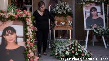 A woman attends the wake of mayoral candidate Alma Barragan in Moroleon, Mexico, Wednesday, May 26, 2021. Barragan was killed Tuesday while campaigning for the mayorship of the city of Moroleon, in violence-plagued Guanajuato state. (AP Photo/Armando Solis)