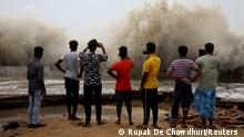 People use their mobile phones to take pictures of waves breaking on a beach front following Cyclone Yaas in Digha, Purba Medinipur district in the eastern state of West Bengal, India, May 27, 2021. REUTERS/Rupak De Chowdhuri TPX IMAGES OF THE DAY