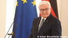 BERLIN, GERMANY - MAY 21: German President Frank-Walter Steinmeier speaks during a special naturalization ceremony held in recognition of the 72nd anniversary of the country's basic law, or Grundgesetz, on May 21, 2021 in Berlin, Germany. German President Steinmeier gave naturalized German citizens from Egypt, the United Kingdom, Iran, Israel, Poland and Turkey their certificates of citizenship along with a copy of the country's federal constitution, or Grundgesetz. Normally such ceremonies are held in the city halls of local districts. (Photo by Adam Berry/Getty Images)