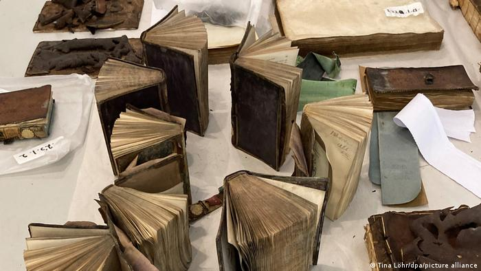water damaged antiquarian books dry out on a table