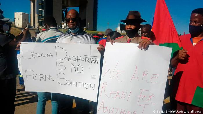 Protesters hold up signs in Windhoek