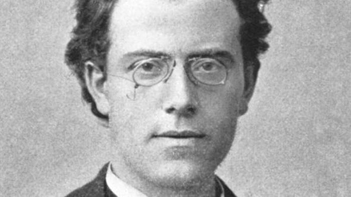 Gustav Mahler in a black and white photo and a confident expression