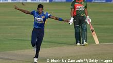 Sri Lanka's Dushmantha Chameera (L) celebrates after the dismissal of Bangladesh's Naim Sheikh (not pictured) as his teammate Tamim Iqbal watches during the third and final one-day international (ODI) cricket match between Bangladesh and Sri Lanka at Sher-e-Bangla National Cricket Stadium in Dhaka on May 28, 2021. (Photo by Munir Uz zaman / AFP) (Photo by MUNIR UZ ZAMAN/AFP via Getty Images)