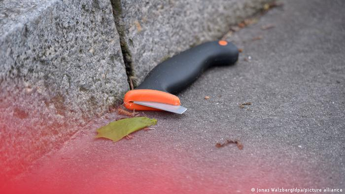 A knife handle with an apparently broken blade at the scene