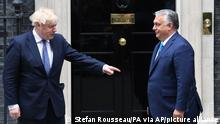 British Prime Minister Boris Johnson, left, welcomes Hungarian President Viktor Orban, at 10 Downing Street, London, Friday, May 28, 2021. Boris Johnson is meeting Friday with Hungarian President Viktor Orban, amid criticism of the decision to invite the hardline European leader to 10 Downing St. Johnson's office said it was a routine meeting with the leader of a major European Union nation. (Stefan Rousseau/PA via AP)