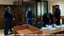 6448023 28.01.2021 In this handout photo released by Moscow's Presnensky District Court, Sayyid-Muhammad Dzhumaev, charged for attacking a police officer during a rally in support of Russian opposition activist Alexey Navalny, attends a hearing at Presnensky District Court in Moscow, Russia. Editorial use only, no archive, no commercial use. Moscow's Presnensky court
