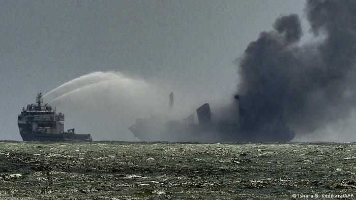 A Navy ship douses the MV X-Press Pearl with water