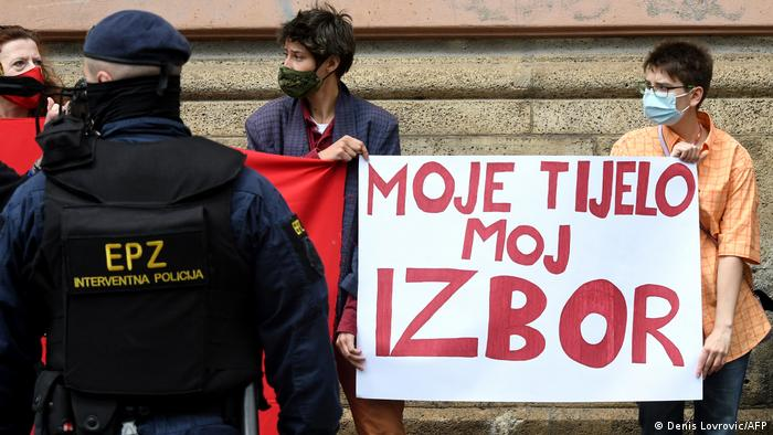 A police officer and pro-abortion activists in Zagreb