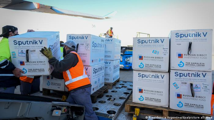Boxes of Sputnik V being unloaded from a plane in Argentina